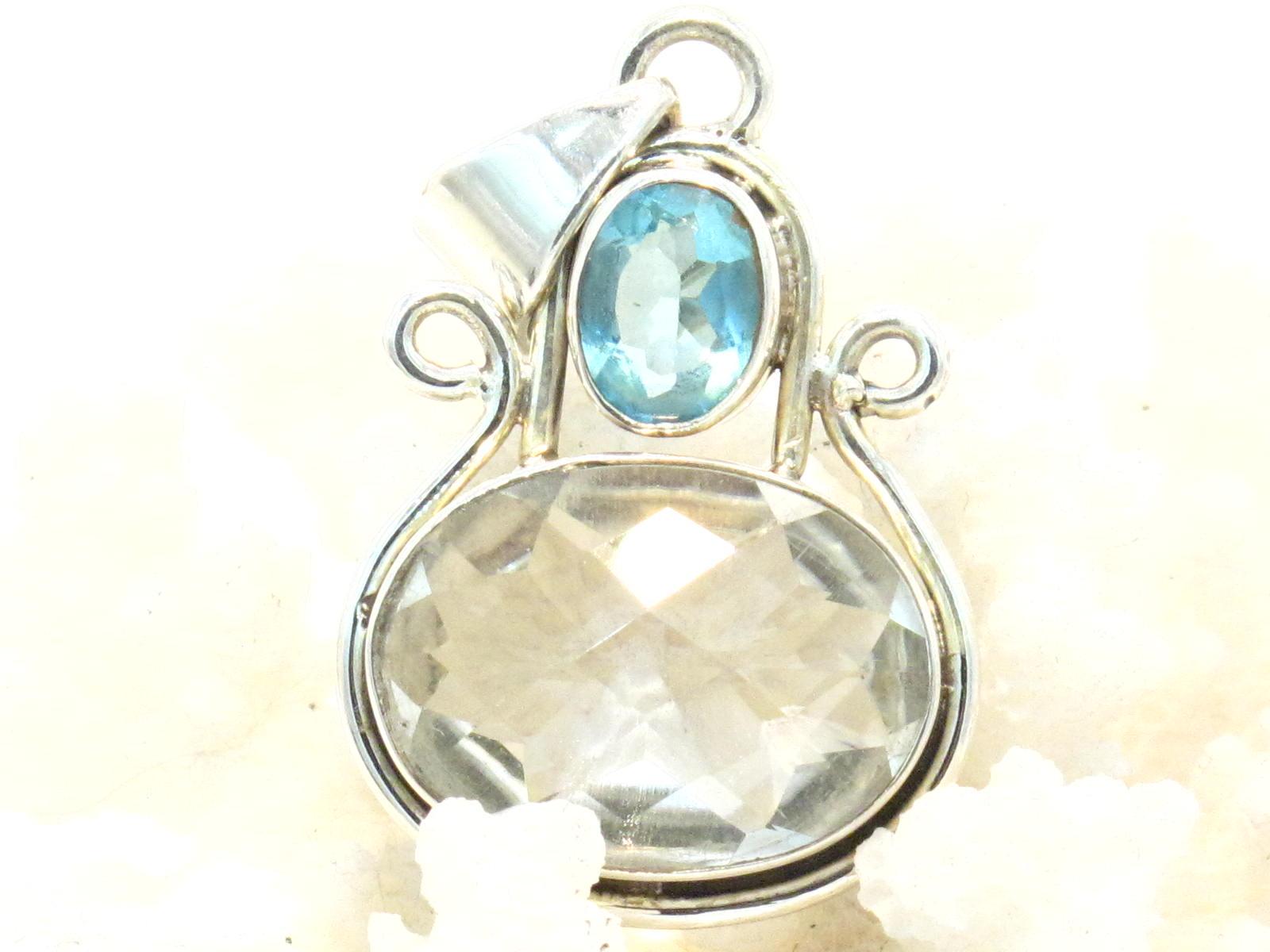 pendente cristallo di rocca e topazio azzurro